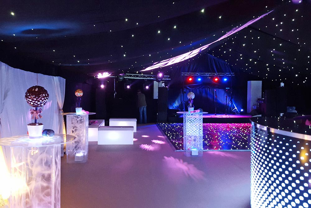 dance floor, bar and chillout area in nightclub-themed marquee by Marlborough Events