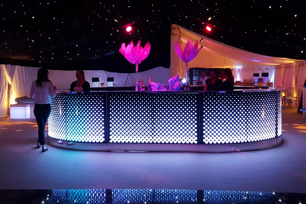 Illuminated bar in twinkling stars marquee by Marlborough Events